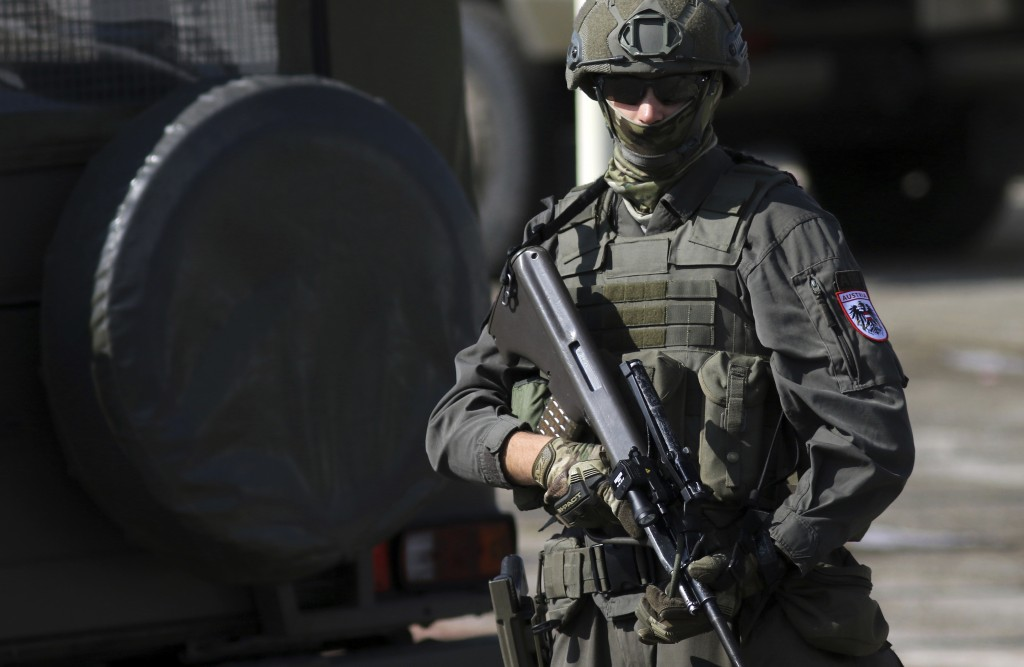 Austrian soldier stands guard during a military exercise in Sarajevo, Bosnia, Friday, Oct. 11, 2019. NATO troops from neighboring Kosovo, as well as t...