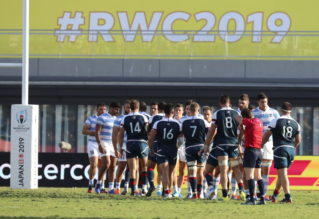 United States and Argentina players shake hands following their Rugby World Cup Pool C game at Kumagaya Rugby Stadium in Kumagaya City, Japan, Wednesd...