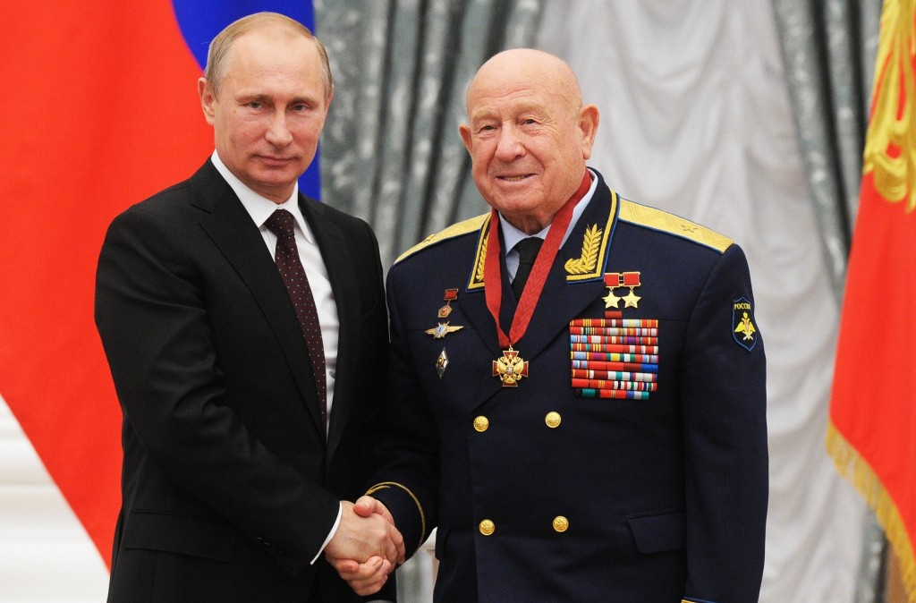 FILE - In this Friday, June 14, 2013 file photo, Russian cosmonaut Alexei Leonov, who made the first spacewalk in 1965, right, and Russian President V