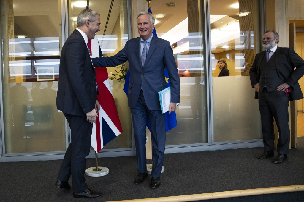 UK Brexit secretary Stephen Barclay, left, is welcomed by European Union chief Brexit negotiator Michel Barnier next to British Ambassador to the EU T...