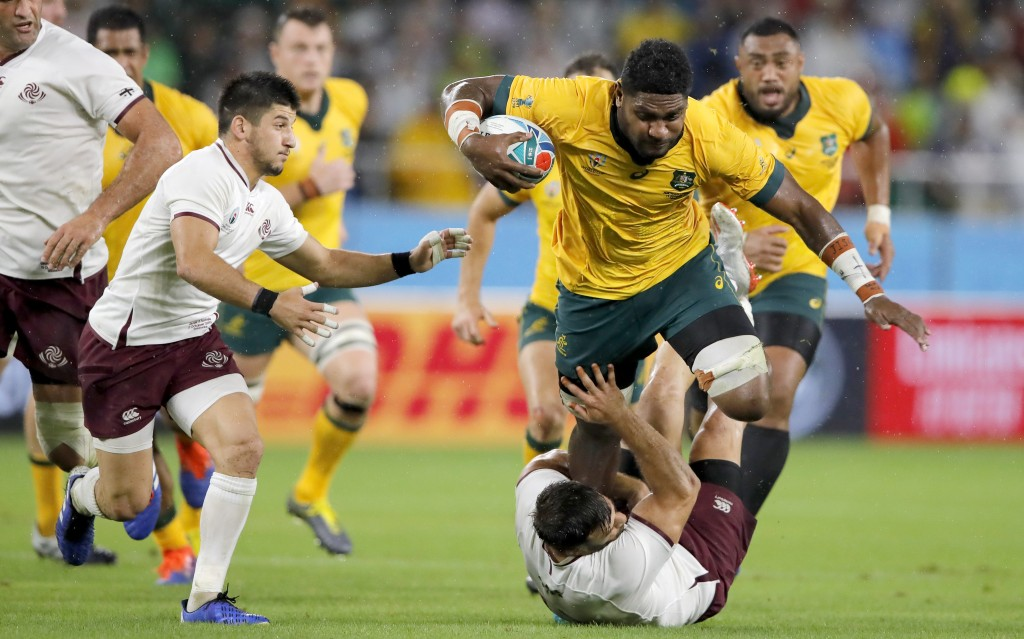 Australia's Isi Naisarani runs at the Georgian defence during the Rugby World Cup Pool D game at Shizuoka Stadium Ecopa between Australia and Georgia