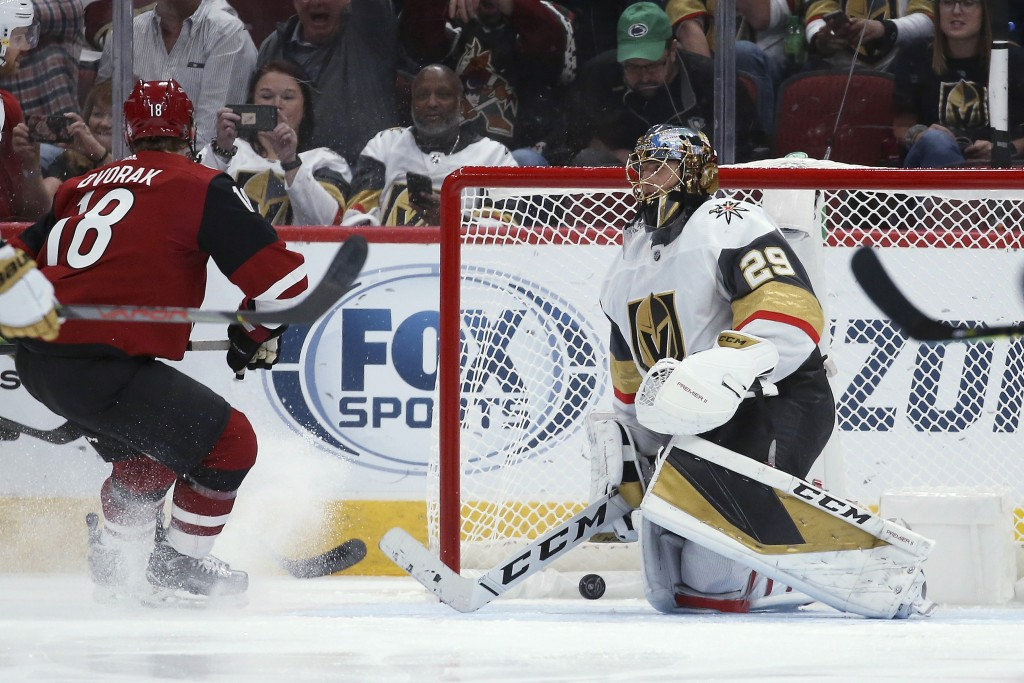Vegas Golden Knights goaltender Marc-Andre Fleury (29) gives up a goal to Arizona Coyotes' Conor Garland, not seen, as Coyotes left wing Christian Dvo