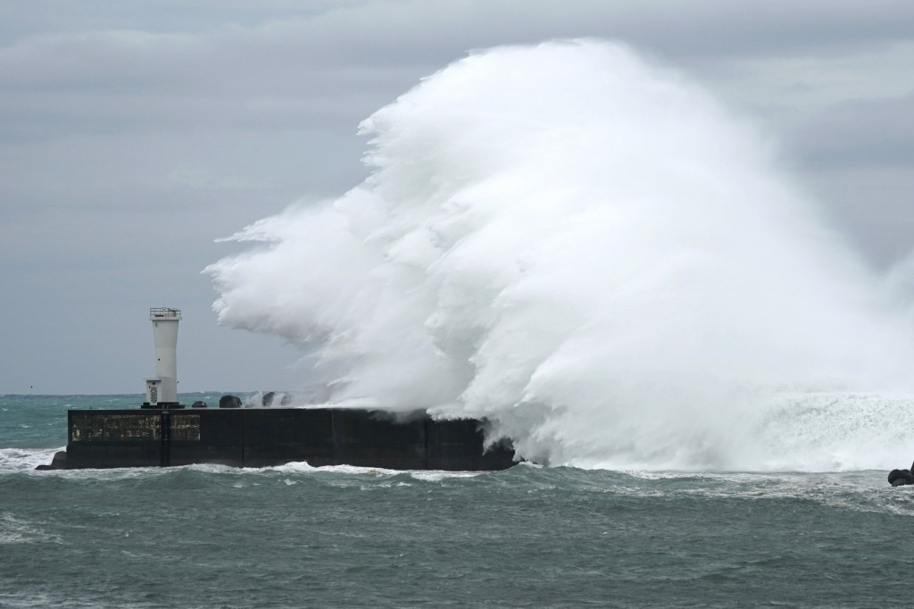 Surging waves hit against the breakwater while Typhoon Hagibis approaches at a port in town of Kiho, Mie prefecture, central Japan Friday, Oct. 11, 20...
