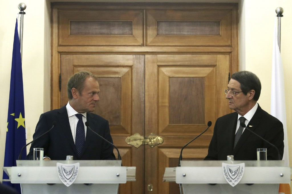 Cyprus' President Nicos Anastasiades, right, and European Council President Donald Tusk talk to the media during a press conference after their meetin...
