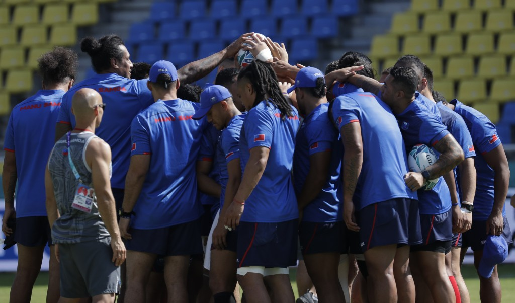 Samoa rugby team players gather during training for the Rugby World Cup Pool A games in at the Fukuoka Hakatanomori Stadium in Fukuoka, Japan, Friday,...