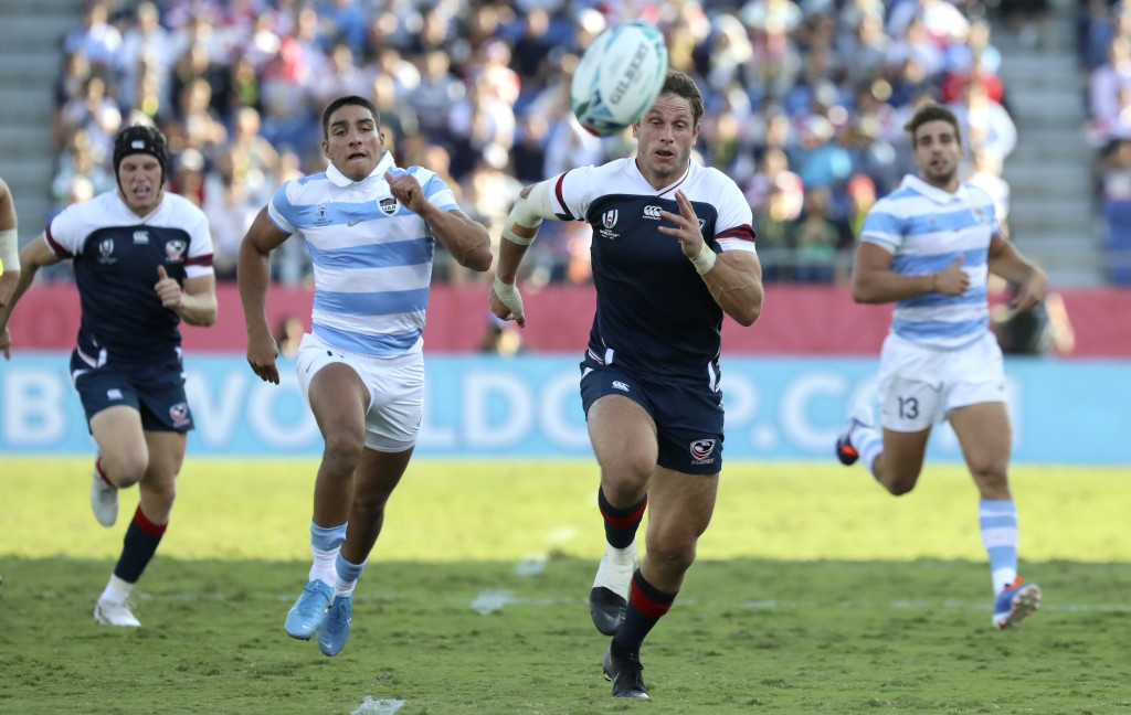 United States' Blaine Scully, right, and Argentina's Santiago Carreras chase the ball during the Rugby World Cup Pool C game at Kumagaya Rugby Stadium...