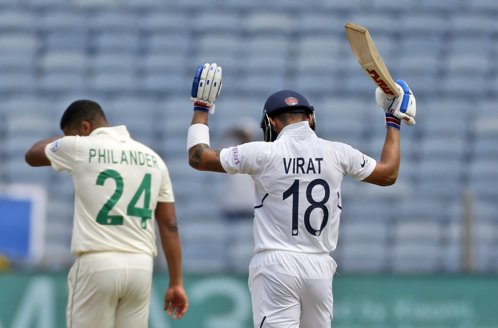 Indian cricketer Virat Kohli celebrates after scoring a century during the second day of the second cricket test match between India and South Africa