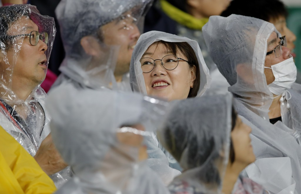 Fans wait for the start of the Rugby World Cup Pool D game at Shizuoka Stadium Ecopa between Australia and Georgia in Shizuoka, Japan, Friday, Oct.11,...