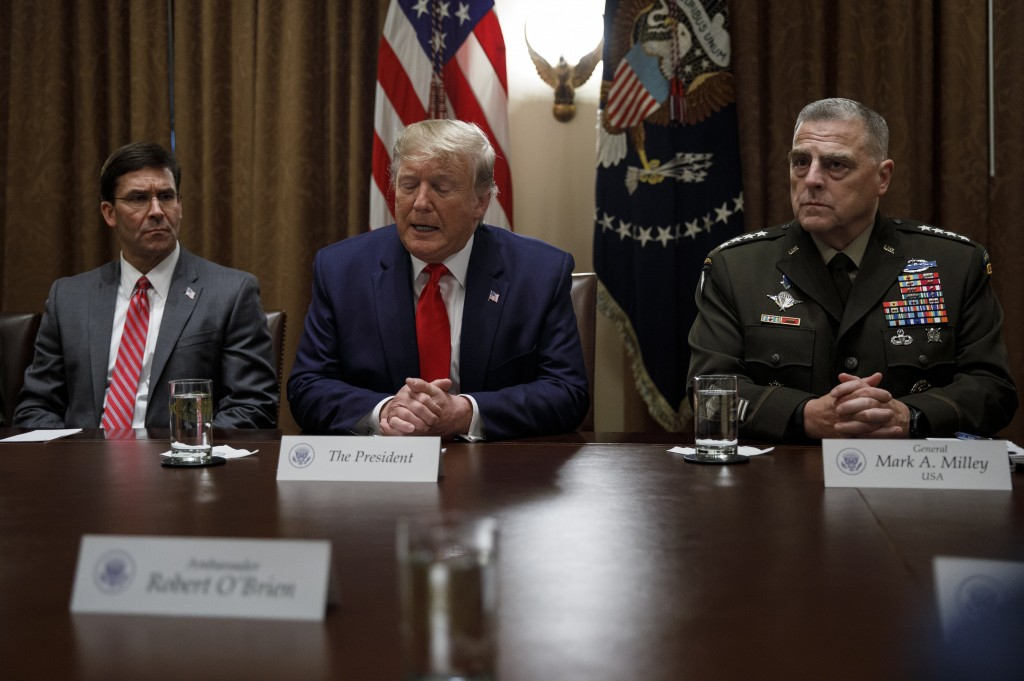 President Donald Trump, joined by from left, Defense Secretary Mark Esper, and Chairman of the Joint Chiefs of Staff Gen. Mark Milley, speaks to media