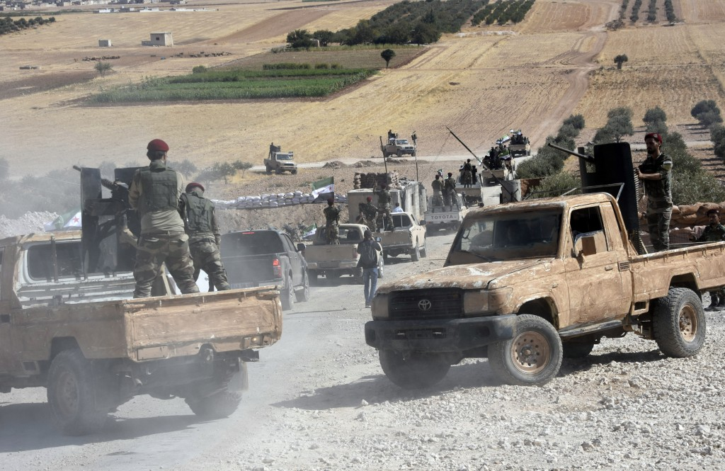 Turkey-backed FSA fighters are heading toward Syrian town of Tal Abyad from Turkish border town of Akcakale, Turkey, Thursday, Oct. 10, 2019. Turkish