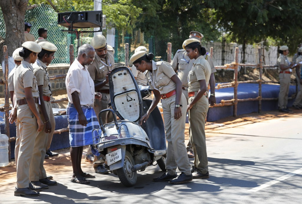 Police officers check a vehicle at the entrance to Mamallapuram, where Indian Prime Minister Narendra Modi and Chinese President Xi Jinping will hold