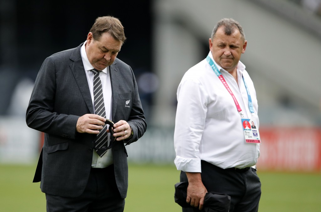All Blacks coach Steve Hansen and his assistant Ian Foster walk on the pitch ahead of the Rugby World Cup Pool B game at Tokyo Stadium between New Zea...