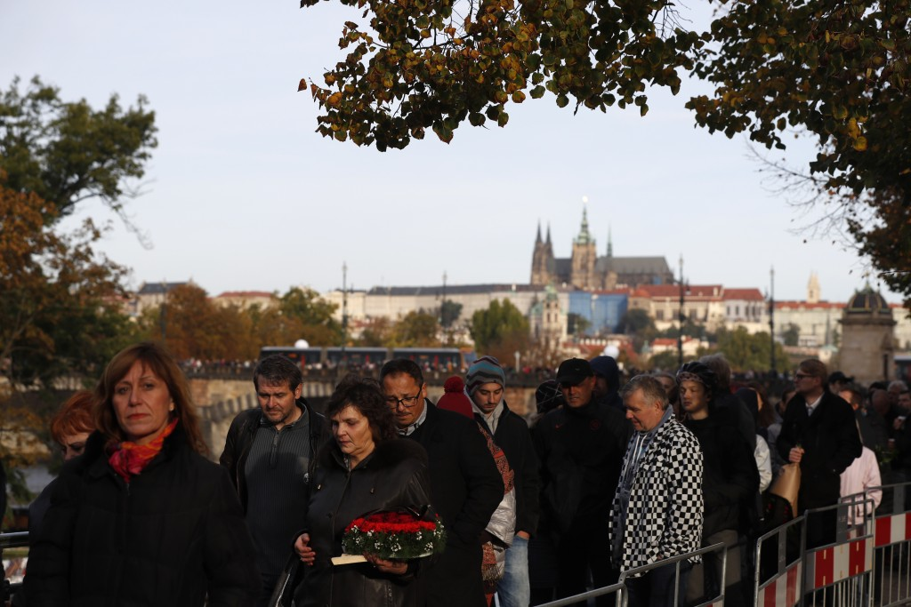 Mourners queue up to pay respect to late Czech famous pop singer Karel Gott during a memorial service in Prague, Czech Republic, Friday, Oct. 11, 2019