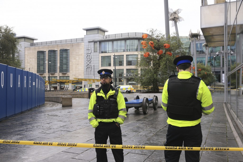 Police outside the Arndale Centre in Manchester, England, Friday October 11, 2019, after a stabbing incident at the shopping center that left four peo