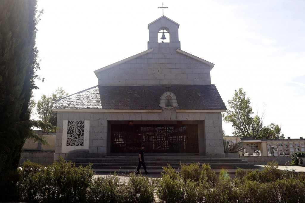 In this photo taken on Thursday, Oct. 3, 2019, a Spanish police walks past Franco's family tomb in Mingorrubio's cemetery, outskirts of Madrid. After ...