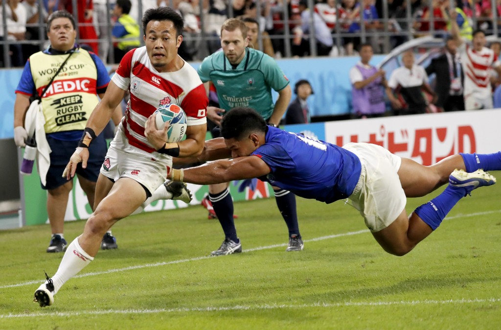 Japan's Kenki Fukuoka runs in to score a try during the Rugby World Cup Pool A game at City of Toyota Stadium between Japan and Samoa in Tokyo City, J