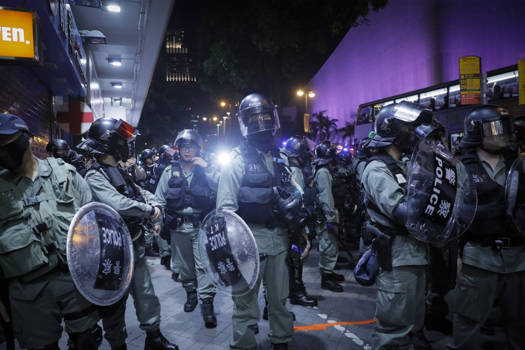 Riot Police petrol with face mask in the Tsim Sha Tsui district in Hong Kong, Thursday, Oct. 10, 2019. A Hong Kong government official said on Thursda