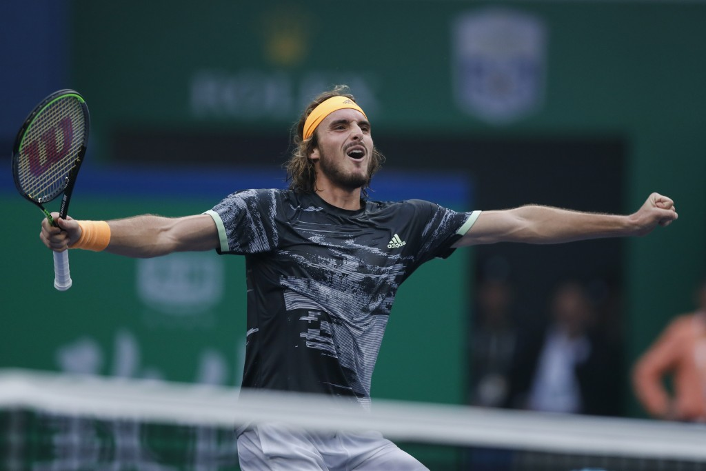Stefanos Tsitsipas of Greece celebrates after defeating Novak Djokovic of Serbia in the men's singles quarterfinals match at the Shanghai Masters tenn...