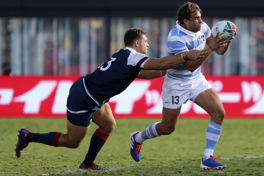 Argentina's Juan Cruz Mallias, right, runs at the defense during the Rugby World Cup Pool C game at Kumagaya Rugby Stadium between US and Argentina in...