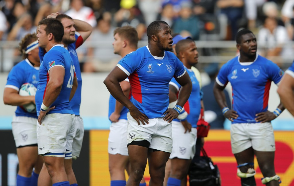 Namibian players react during the Rugby World Cup Pool B game at Tokyo Stadium between New Zealand and Namibia in Tokyo, Japan, Sunday, Oct. 6, 2019. ...