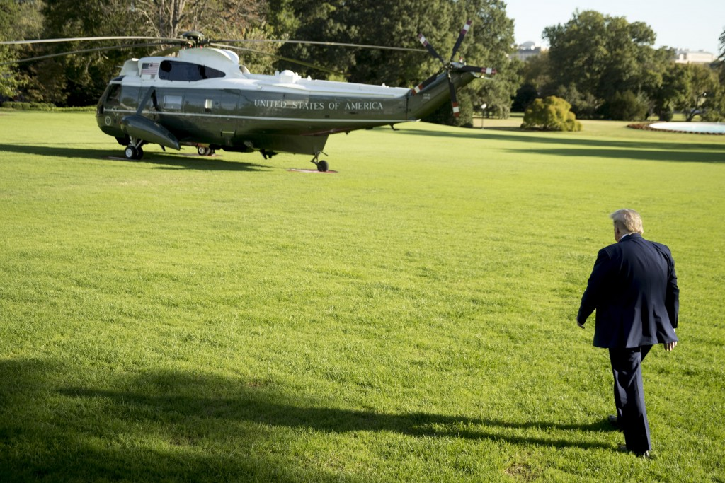 President Donald Trump walks across the South Lawn of the White House in Washington, Thursday, Oct. 10, 2019, before boarding Marine One for a short t...