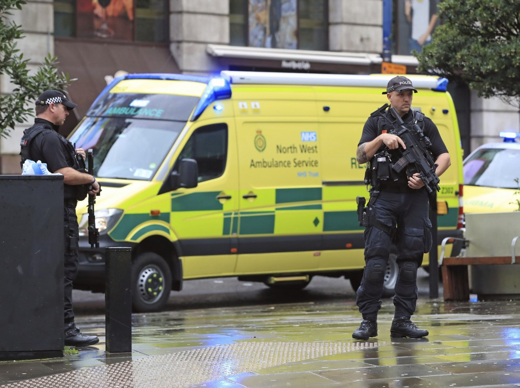 Police outside the Arndale Centre in Manchester, England, Friday October 11, 2019, after a stabbing incident at the shopping center that left four peo...
