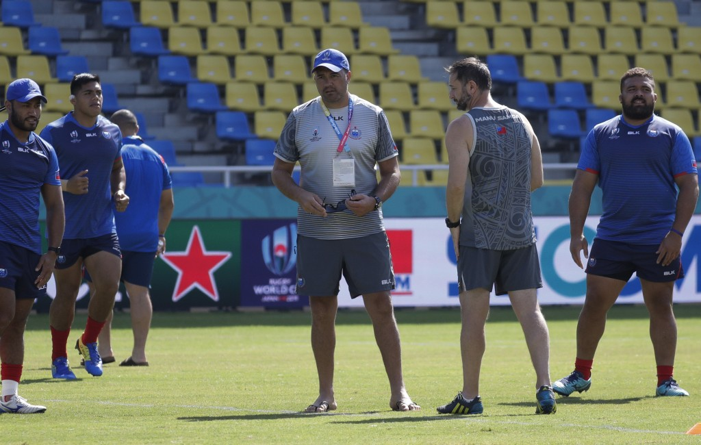 Samoa rugby coach Vaeluaga Steve Jackson, center, watches during their training for the Rugby World Cup Pool A game in Fukuoka, Japan, Friday, Oct. 11...