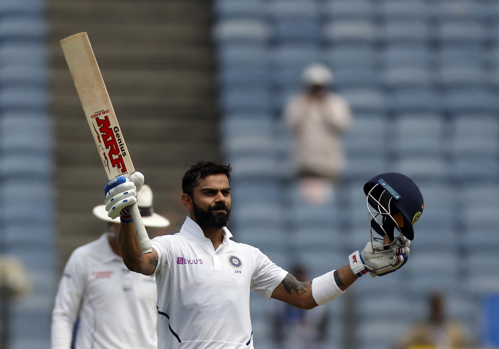 Indian cricketer Virat Kohli celebrates after scoring a century during the second day of the second cricket test match between India and South Africa ...