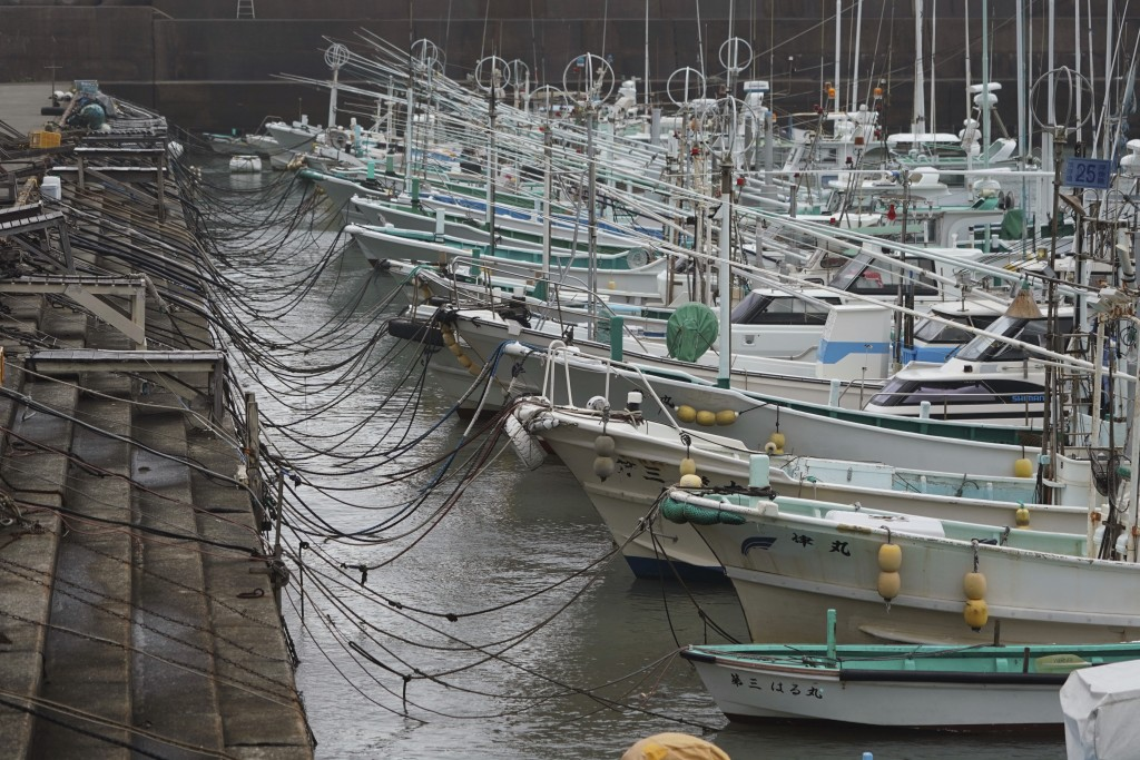 Fishing boats are anchored at a port as Typhoon Hagibis approaches in town of Kiho, Mie Prefecture, Japan Friday, Oct. 11, 2019. A powerful typhoon is...