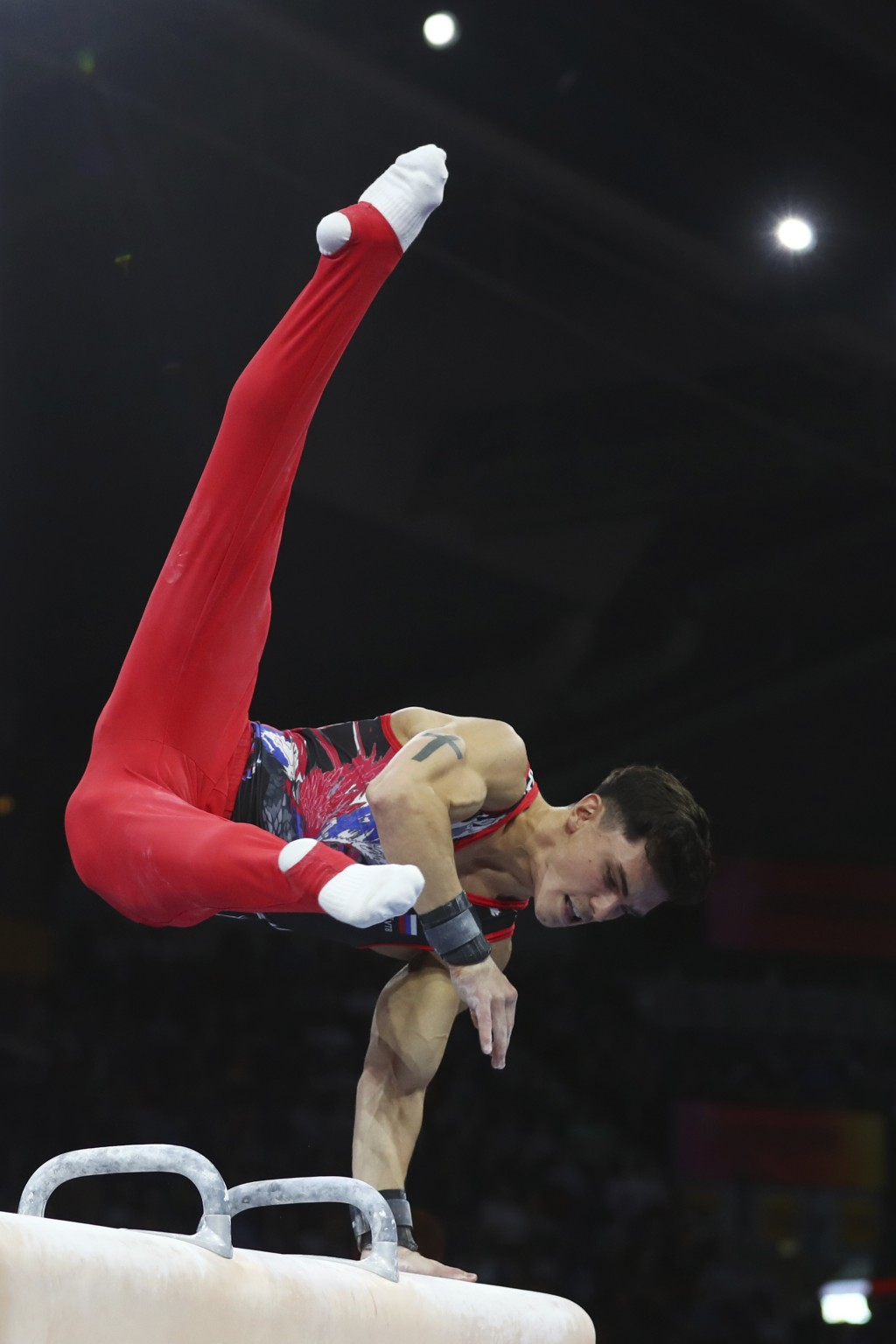 Artur Dalaloyan of Russia performs on the pommel horse in the men's all-around final at the Gymnastics World Championships in Stuttgart, Germany, Frid