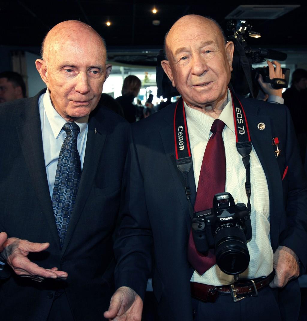FILE - In this Monday, April 11, 2011 file photo, retired NASA astronaut Thomas Stafford, left, and retired Russian cosmonaut Alexei Leonov visit an e...