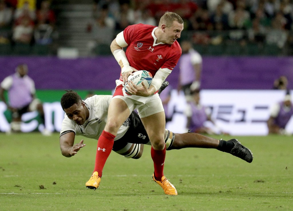 Wales' Hadleigh Parkes makes a run pas a Fijian tackler during the Rugby World Cup Pool D game at Oita Stadium between Wales and Fiji in Oita, Japan,