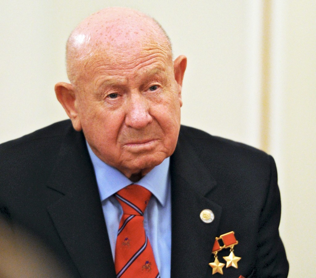 FILE - In this Friday, June 14, 2013 file photo, Russian cosmonaut Alexei Leonov, who made the first spacewalk in 1965, attends a meeting with Russian