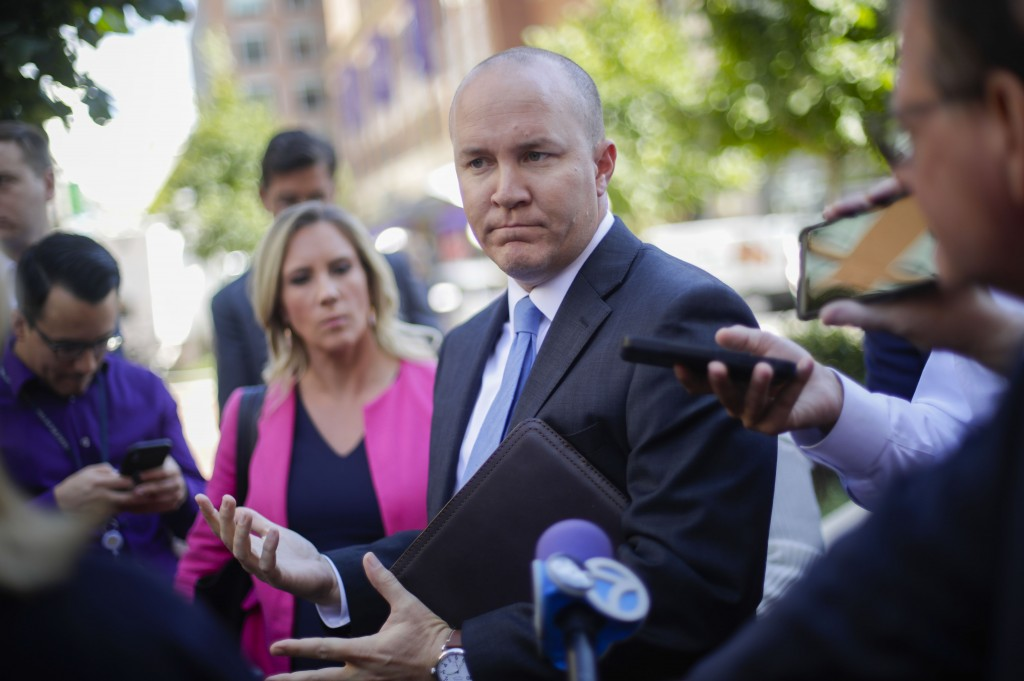 Joshua Stueve, public affairs officer with the  U.S. Department of Justice U.S. Attorney's Office, speaks outside the the federal courthouse in Alexan