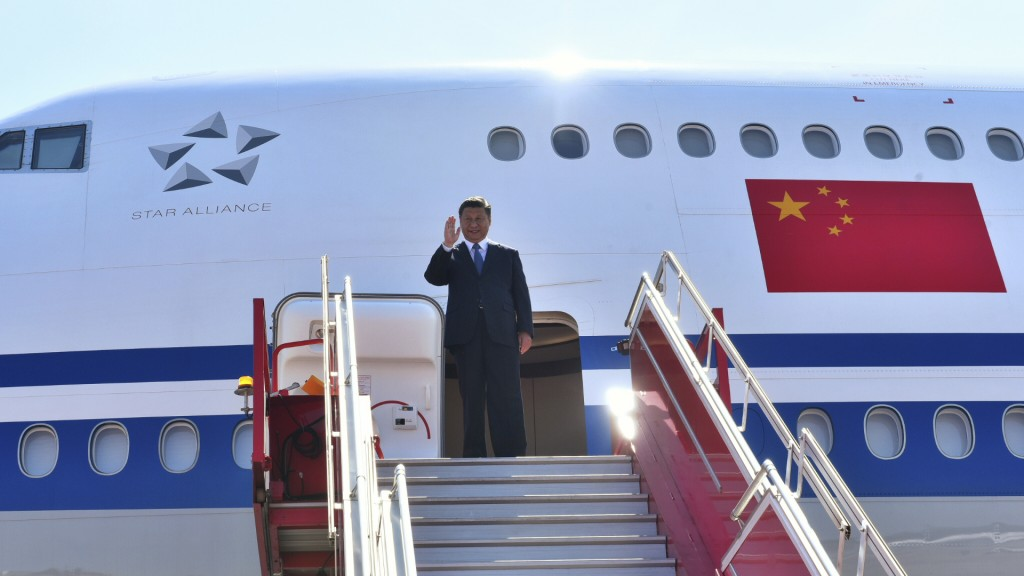 In this handout photo provided by the Indian Ministry of External Affairs, Chinese President Xi Jinping waves to the gathering as he arrives in Chenna
