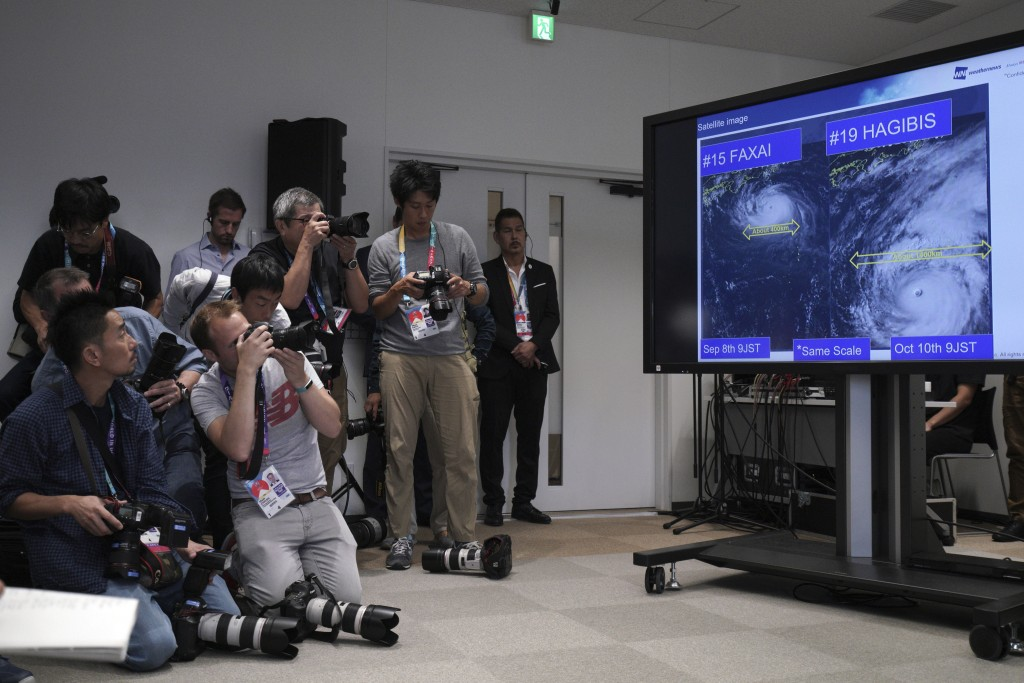 A satellite photo of typhoon Hagibis is seen during a press briefing on update relating to the anticipated impact of Typhoon Hagibis on the final roun...