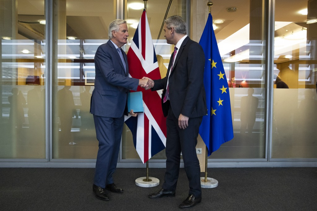 UK Brexit secretary Stephen Barclay, left, shakes hands with European Union chief Brexit negotiator Michel Barnier before their meeting at the Europea