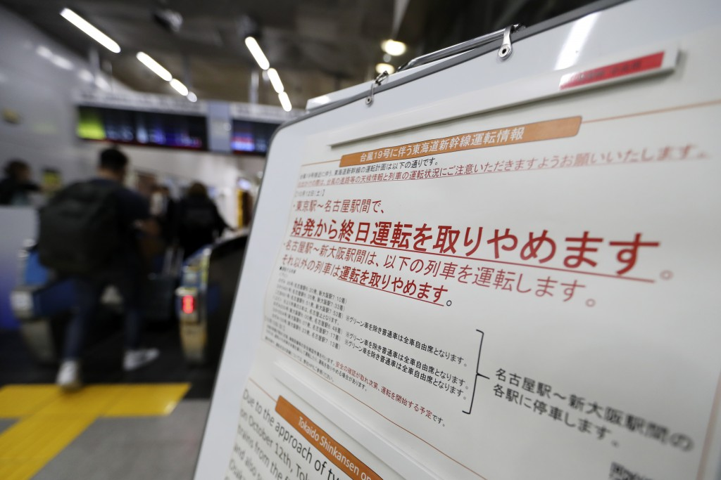 A notice paper on suspending operations of the Shinkansen or bullet train on Oct. 12-13 due to Typhoon Hagibis, is posted at Tokyo Station in Tokyo Fr