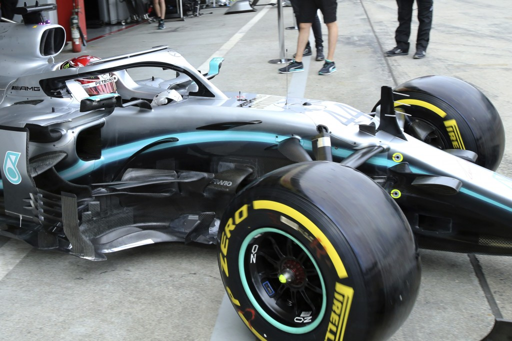 Mercedes driver Lewis Hamilton of Britain steers his car out of the garage during the first practice session for the Japanese Formula One Grand Prix a...