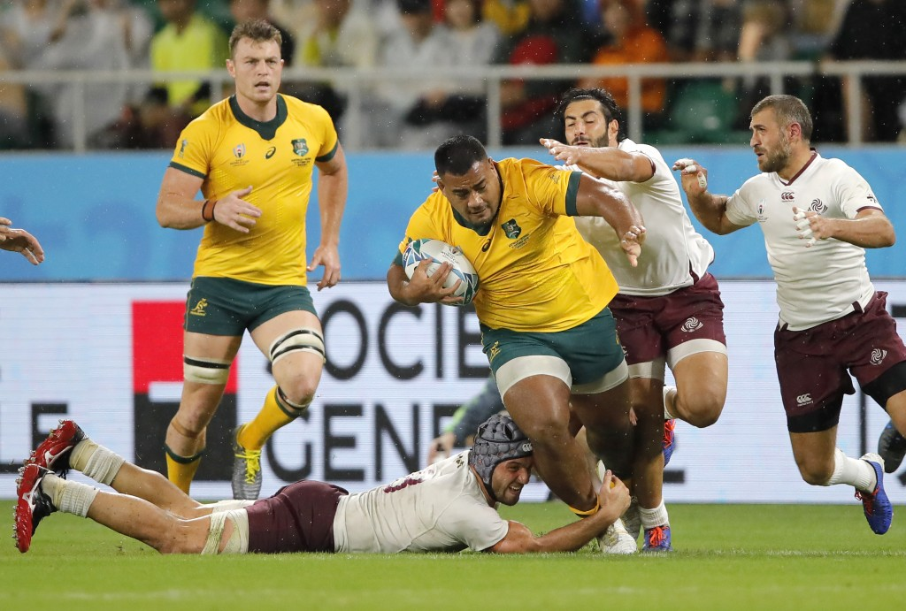 Australia's Taniela Tupou is tackled by Georgian defenders during the Rugby World Cup Pool D game at Shizuoka Stadium Ecopa between Australia and Geor...