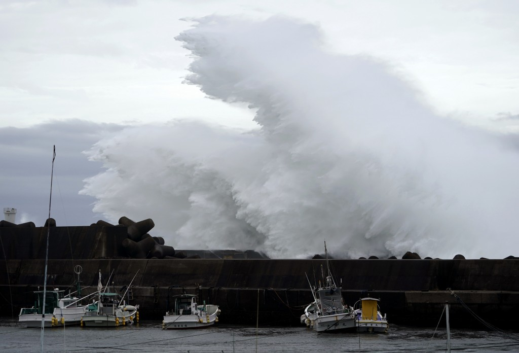 Surging waves hit against the breakwater while Typhoon Hagibis approaches at a port in town of Kiho, Mie prefecture, Japan Friday, Oct. 11, 2019. A po...