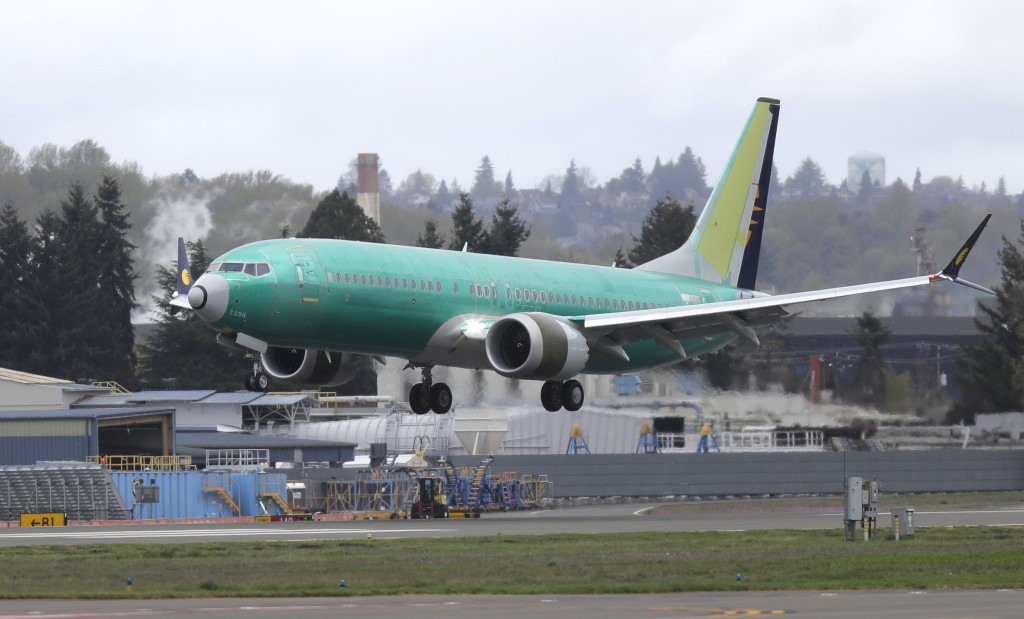 FILE - In this April 10, 2019 photo, a Boeing 737 MAX 8 airplane being built for India-based Jet Airways lands following a test flight at Boeing Field...
