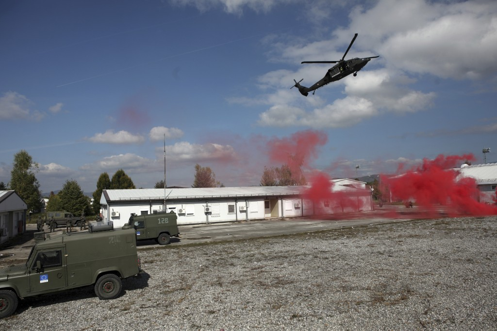 A NATO helicopter takes part in a military exercise in Sarajevo, Bosnia, Friday, Oct. 11, 2019. NATO troops from neighboring Kosovo, as well as the Bo...