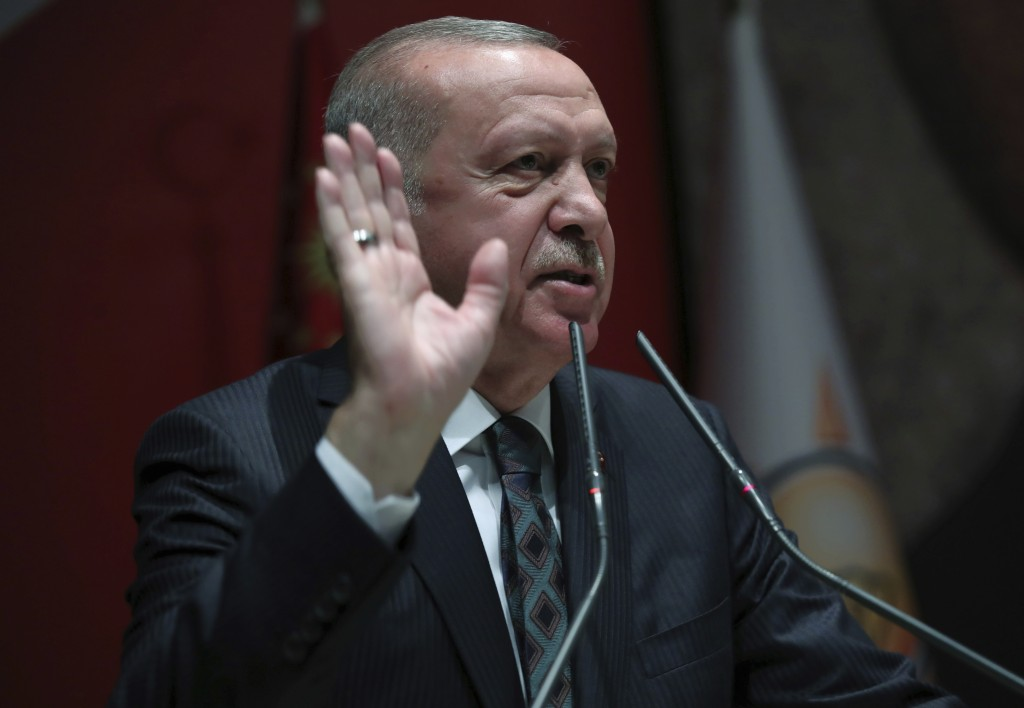 Turkey's President Recep Tayyip Erdogan speaks to his ruling party officials, in Ankara, Turkey, Thursday, Oct. 10, 2019. Erdogan says that there have