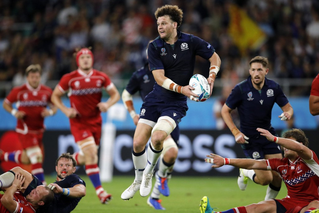 Scotland's Duncan Taylor passes the ball during the Rugby World Cup Pool A game at Shizuoka Stadium Ecopa between Scotland and Russia in Shizuoka, Jap...