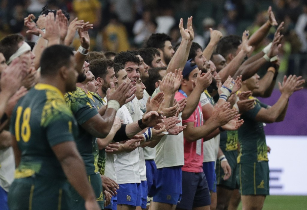 Australian and Uruguay wave to the crowd following their Rugby World Cup Pool D game at Oita Stadium in Oita, Japan, Saturday, Oct. 5, 2019. Australia