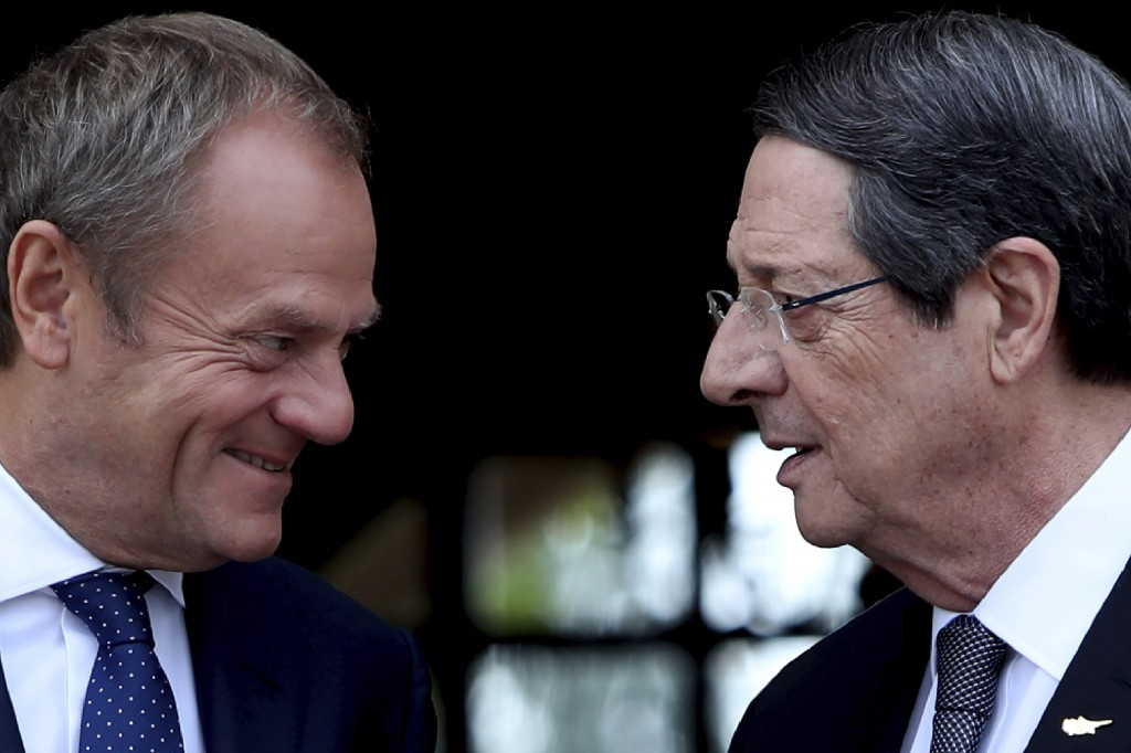 Cyprus' President Nicos Anastasiades, right, talks with European Council President Donald Tusk as he arrives for a meeting at the presidential palace ...