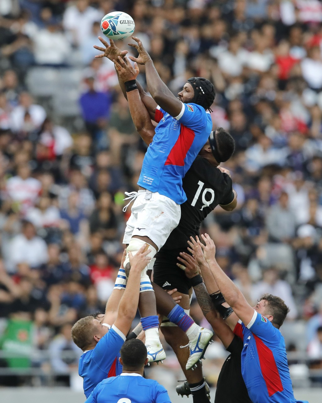 Namibia's Tjiuee Uanivi wins the lineout ball ahead of New Zealand's Patrick Tuipulotu during the Rugby World Cup Pool B game at Tokyo Stadium between