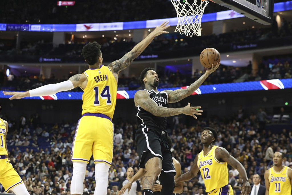 Brooklyn Nets' Wilson Chandler goes to the basket against Los Angeles Lakers' Danny Green, left, during a preseason NBA game in Shanghai, China, Thurs