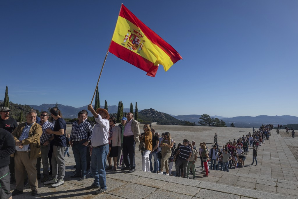 In this Saturday, Oct. 5, 2019 photo, visitors queue to enter at the Valley of the Fallen mausoleum near El Escorial, outskirts of Madrid, Spain, Satu...